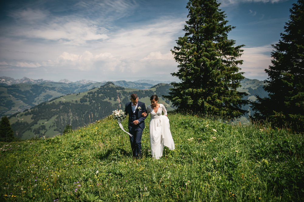 couple walking during their mountain wedding