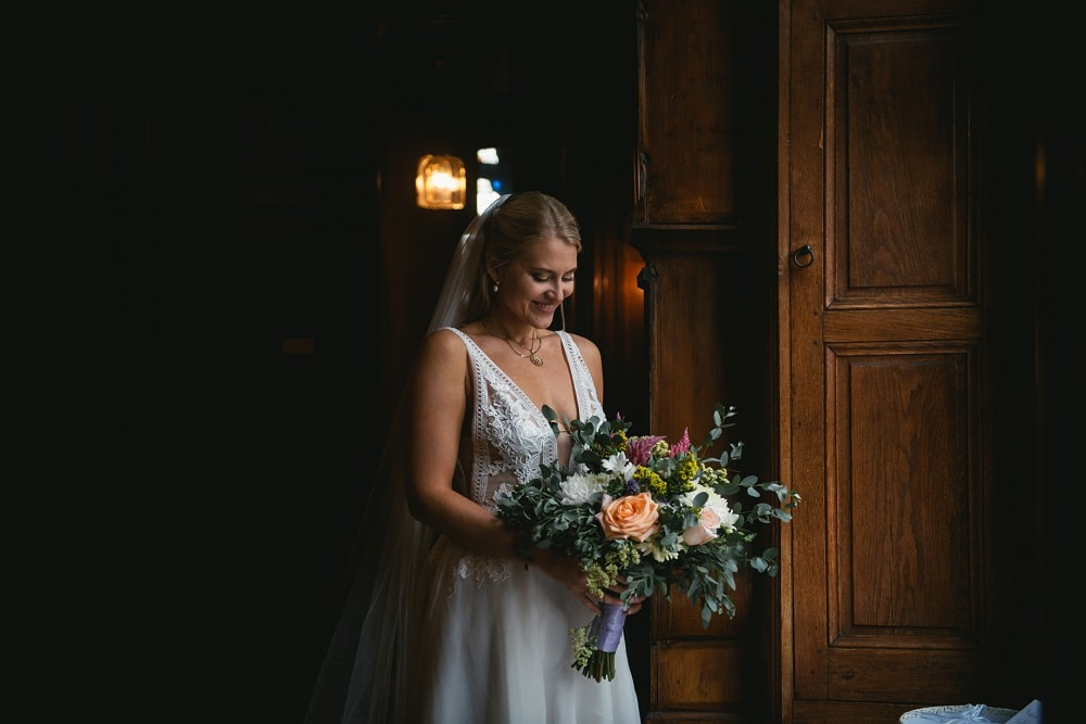 bride holding her bouquet of fresh flowers