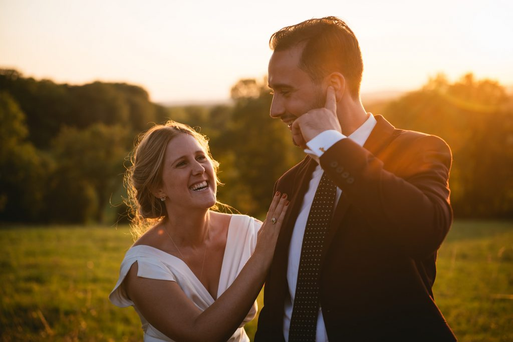 couple laughin after their wedding in bordeaux